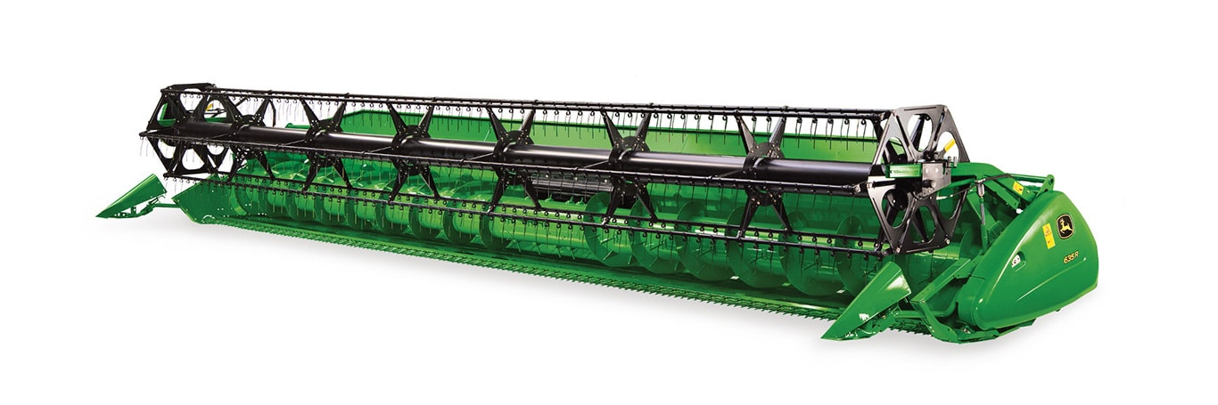 Retractable fingers are positioned over the full width of the auger for smooth, even feeding. Retainers prevent any broken fingers from entering the combine.